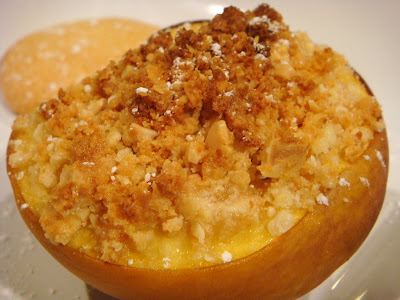 warm peach with amaretti crumble plated with amaretti cookie