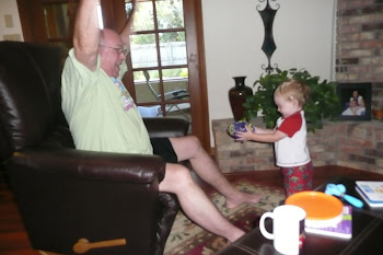 Kaleb catching the football with Grandpa!