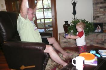 Kaleb catching the football with Grandpa!