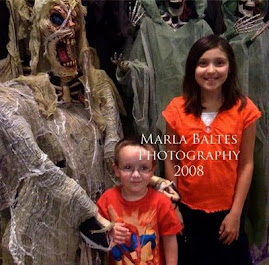Christian and Maizie at the Halloween store