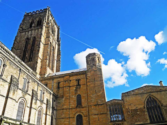 A plane flying over the Cathedral