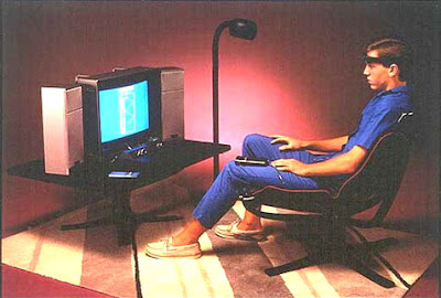 Atari Mindlink. Image of a Karate Kid looking gamer playing an Atari VCS game of Mind Breakout - using muscles in his forehead.