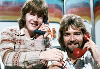 Image of Keith Chegwin and Noel Edmonds on the Multi-Coloured Swap Shop (c. 1982).