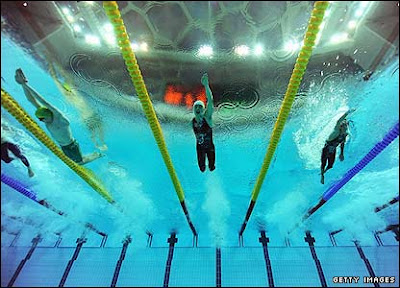 Image of Paralympic swimmers racing.
