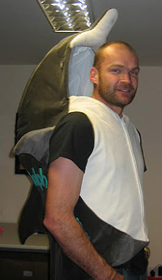 Image of a man wearing a Dolphin suit/back-pack ready for the London Marathon.