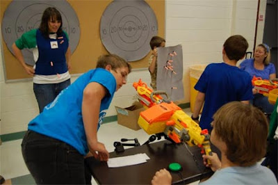 Image of the gigantic one switch adapted Nerf Guns and the targets to hit in front, including humans!.