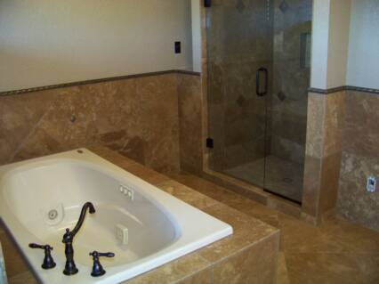 A + TILE HOME REMODELING 205-422-1758: Travertine Bathroom