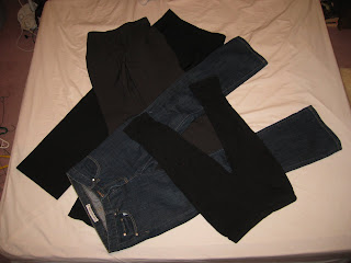 Two pairs of trousers, a pair of leggings, and jeans
