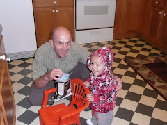 my dad and Helaman....the next few pics are of Helaman pushing the chair around the kitchen
