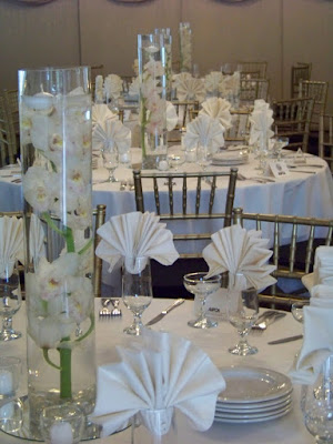 Centerpieces today were tall cylinders with cymbidium orchids under water