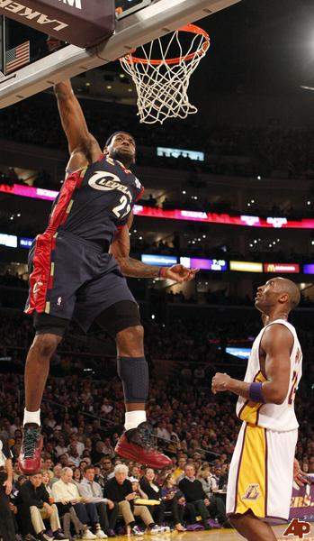 lebron james dunking on kobe bryant. kobe bryant dunks on lebron.
