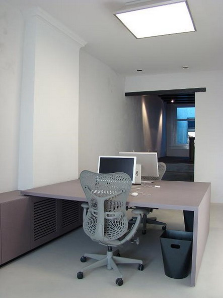 desk office design. modern new office furniture with luxurious supported by appropriate arrangement of space, tables are made one his feet against the wall desk design