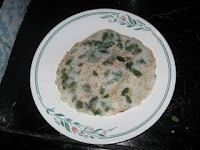 Coconut dosa with drumstick leaves