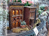 model train garden houses surrounded by poinsettias