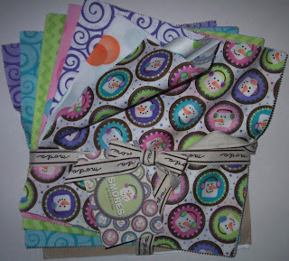 Moda cake squares of a new fabric line
