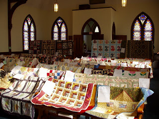 another view of the church pews and quilts