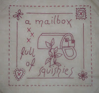 June stitchery block with a mailbox