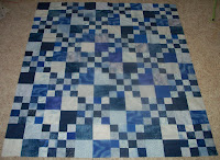 Double Four Patch quilt in blues