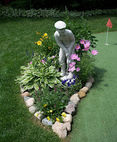 Golfing statue among flowers