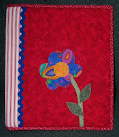 notebook cover made from fabric with an appliqued flower on the front received from the Pay It Forward I signed up for at Linda's blog