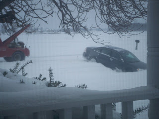 Sherry's car facing north and south in the ditch between our driveways