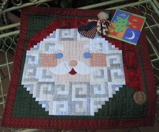 Santa wallhanging and two ornaments