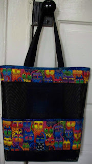 black tote bag with cat fabric pockets and trim