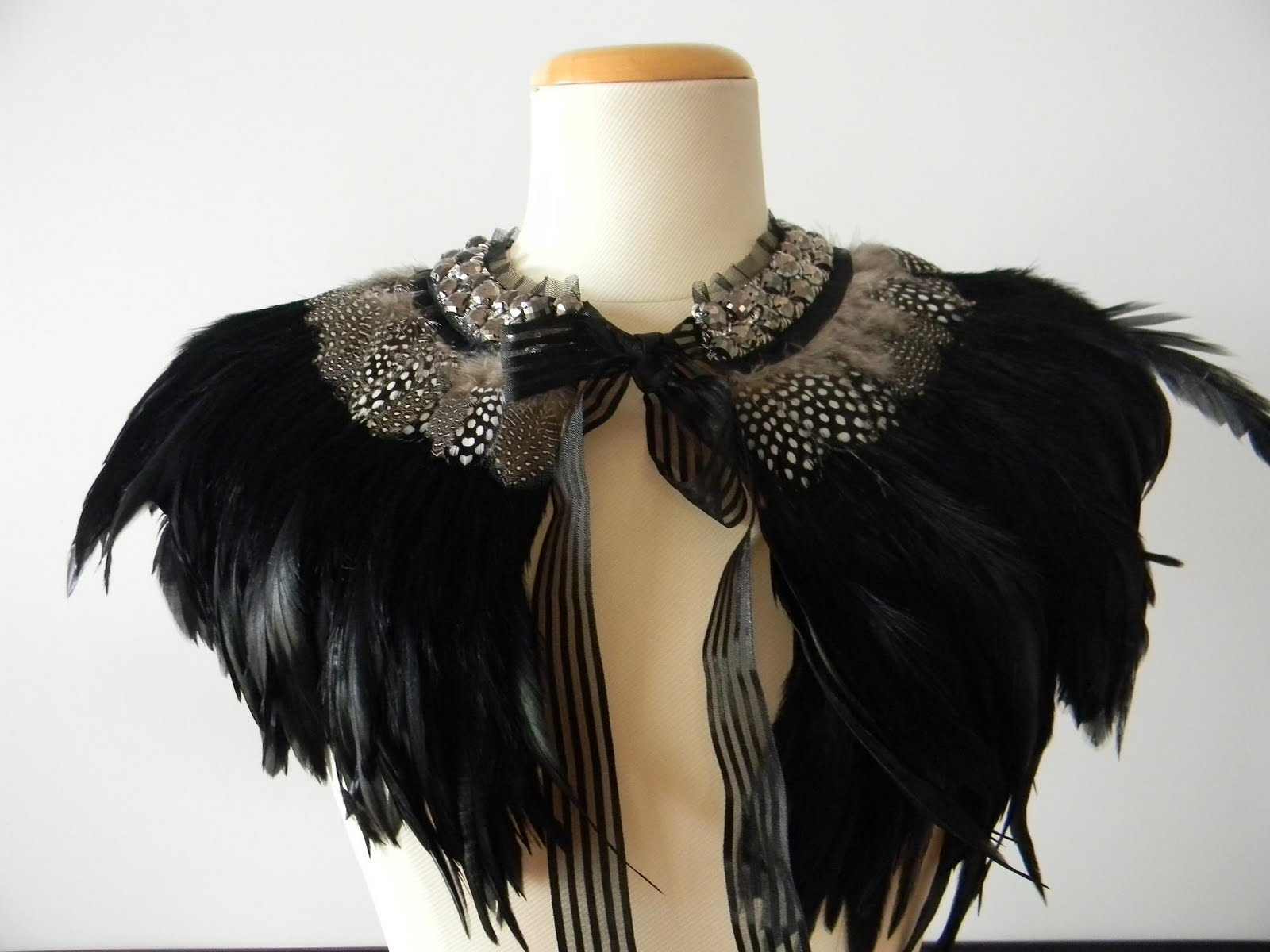 Soniam designs feather capes for Cape designs