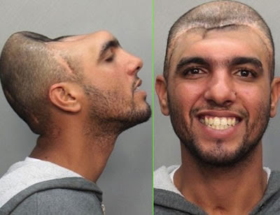 No, it's not photoshop. carlos rodriguez was arrested for attempting