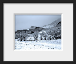 A framed photo of a cold winter's day in the canyon brings snow and fog to the foothills of Colorado.