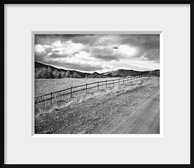 framed black and white photo of western fence line and valley view in Colorado