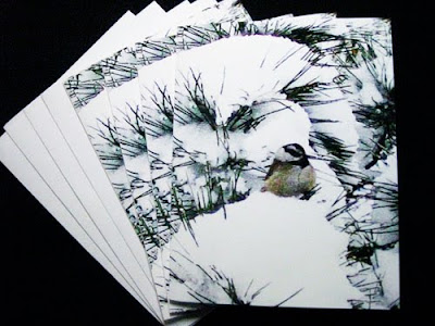 set of four holiday notecards with chickadee in snowy pine boughs