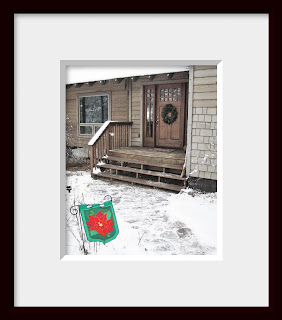 A framed photo of my very own front door and snowy stone walk decorated for the holidays beckon the weary traveler to stop in for a cup of hot chocolate.