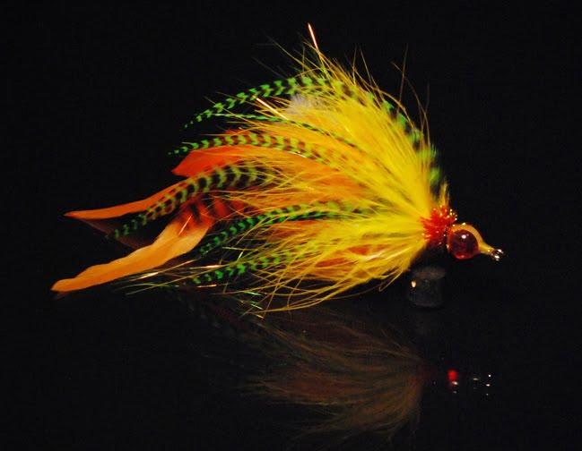 Then added a wide hot orange & green grizzly barbed chevron hackle to each ...