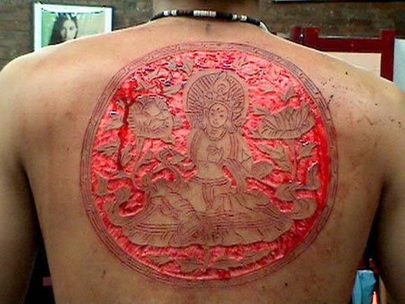 scarification tattoo. scarification tattoo.