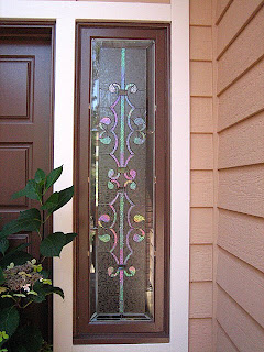 this homeowner asked me to replicate the design of his iron gate for his two stained glass sidelight windows i added a clear bevel border to frame the