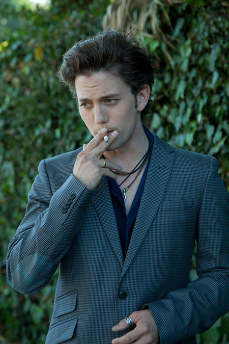 Jackson Rathbone smoking a cigarette (or weed)
