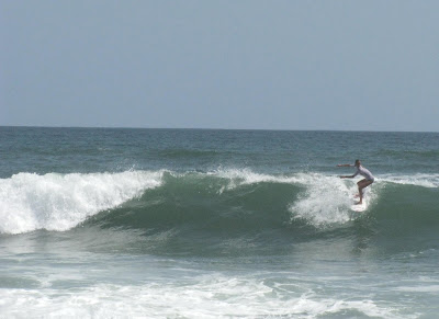 Chelsea Tuach surfing