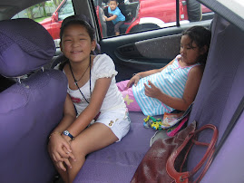 lojeena in side car with her cousin