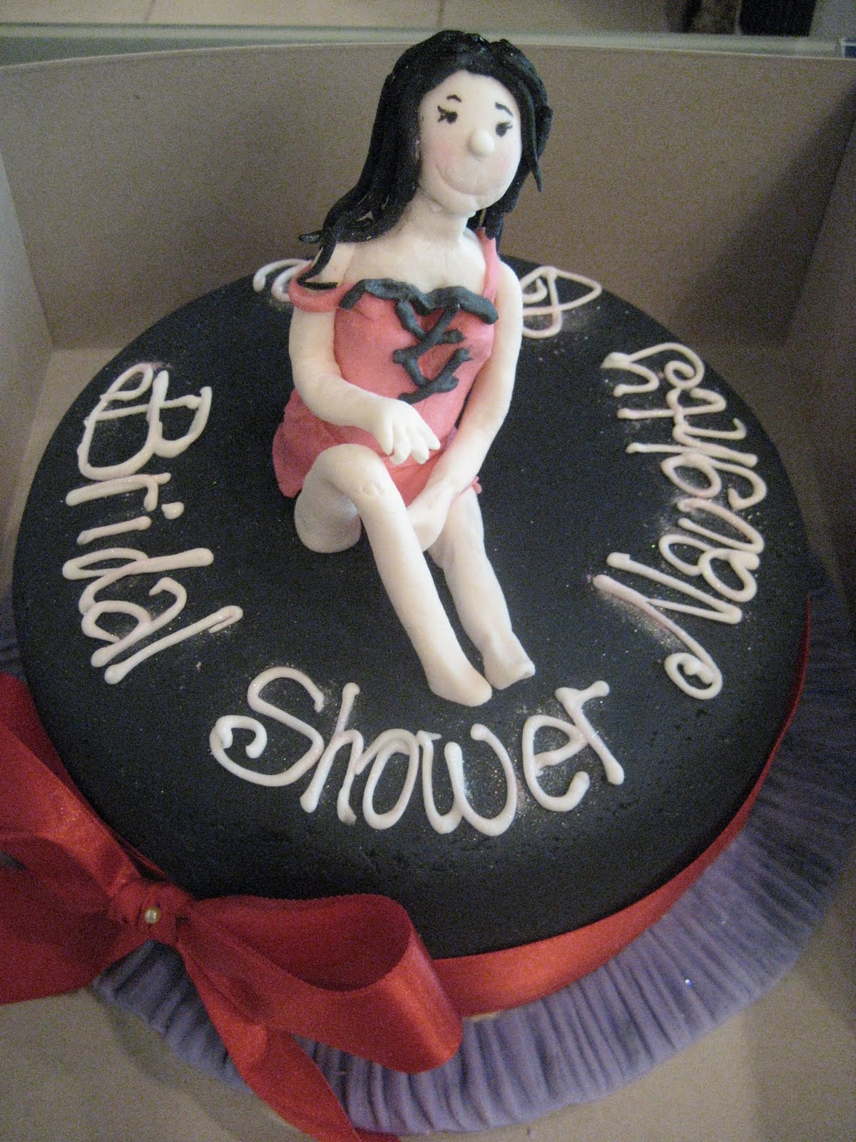 i had a request for a naughty and nice bridal shower cake this was fun to make but reckon the girl could have been sexier
