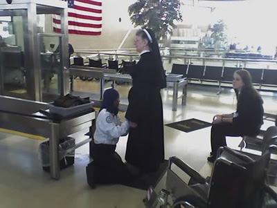 TSA frisking nun