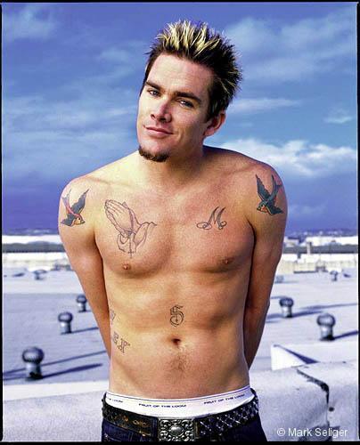 gun tattoos on waist. Mark has varies tattoos