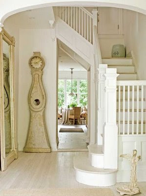 A Swedish Mora Clock (like The One In Somethingu0027s Gotta Give), A Ceramic  Garden Stool, Floor Mirror, And Whitewashed Stairs. So Much To Love In One  Space.