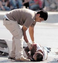 The Body of One of the Victims Lays on the Street