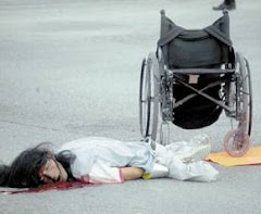 Beggar in Wheel Chair Shot When the Light Turned Red