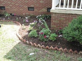 My work brick around flower beds for Brick flower garden designs