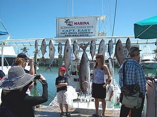 mom and son with kingfish and tuna