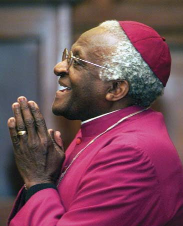 DESMOND TUTU YIELDS THE STAGE.