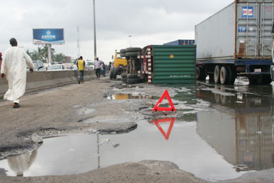 POTHOLES-FILLED ROADS, ADDS TO COST OF DOING BUSINESS IN NIGERIA.