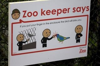 funny sign at the zoo photo birds will bite you dont put fingers in enclosure